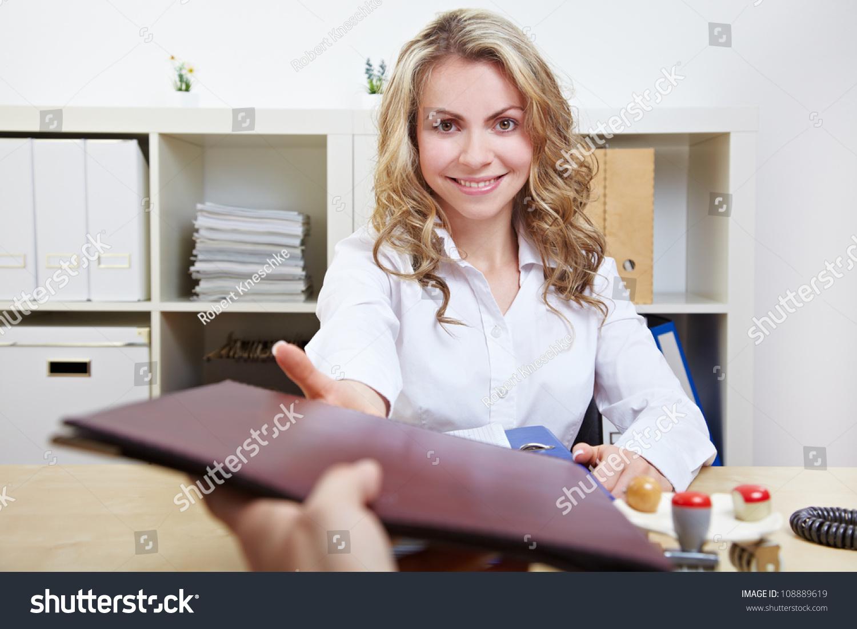 smiling hr w having job interviews and receiving portfolios save to a lightbox