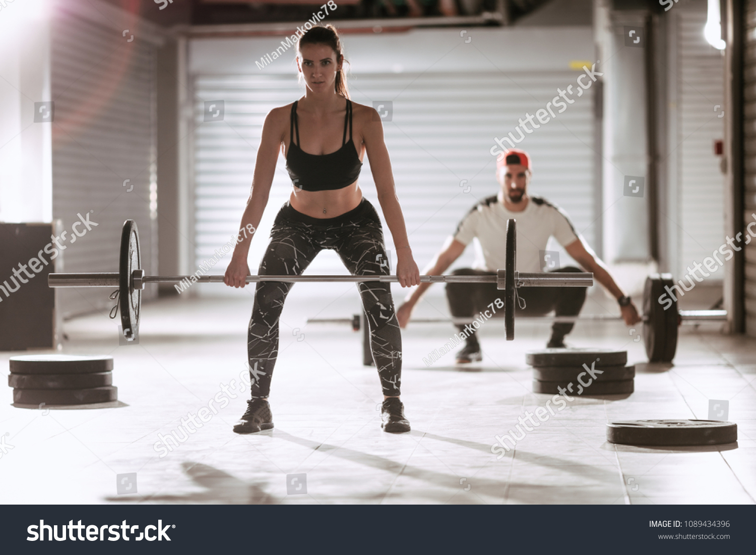 Young muscular couple doing deadlift exercise stock photo edit now