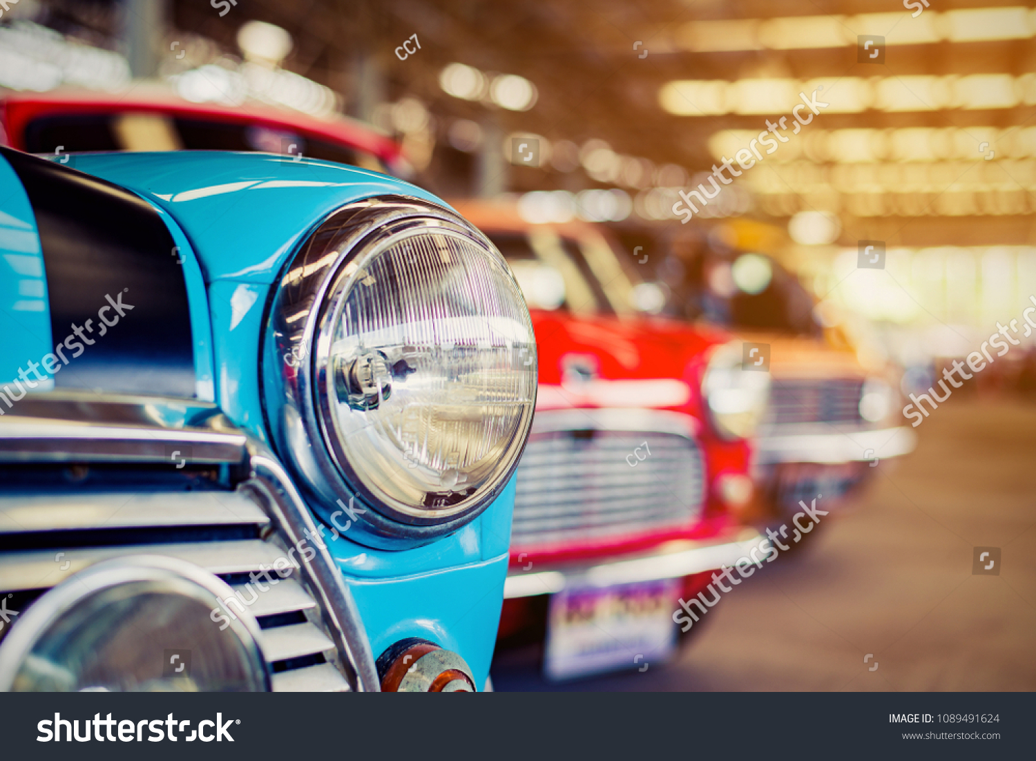 Close-up of headlights of red vintage car in a row.  #1089491624