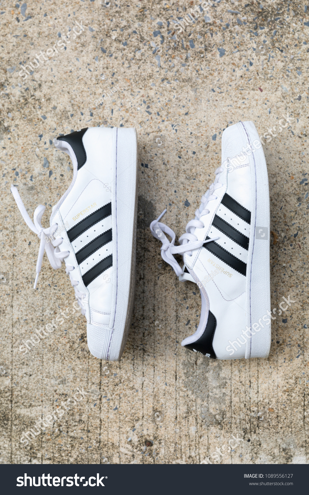 watch f2db8 e37fa BANGKOK, THAILAND - MAY 5, 2018   Adidas Superstar shoe white color stripes  black with popular fashion Thailand on street floor in urban. - Image