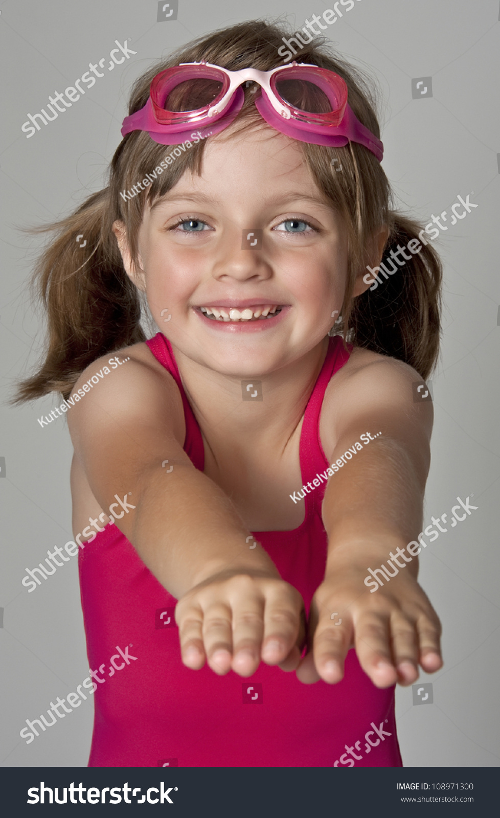 Little Girl Wearing Pink Swimsuit Isolated Stock Photo ...