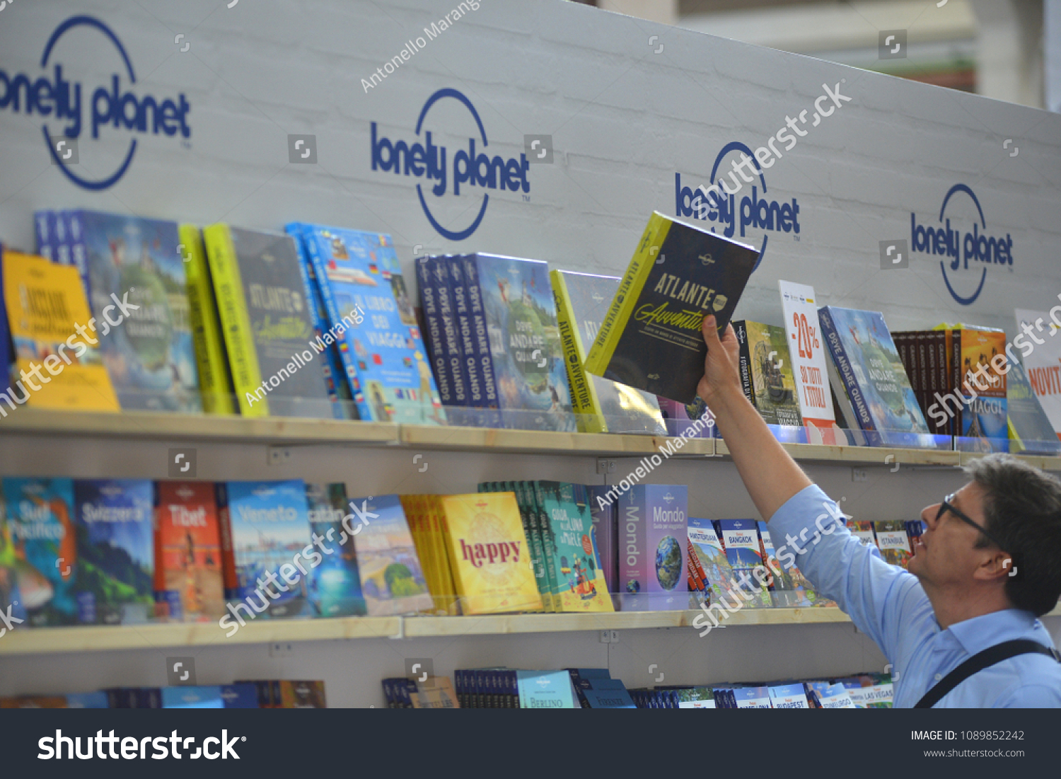 Man Picking Book Lonely Planet Publishing Stock Photo (Edit