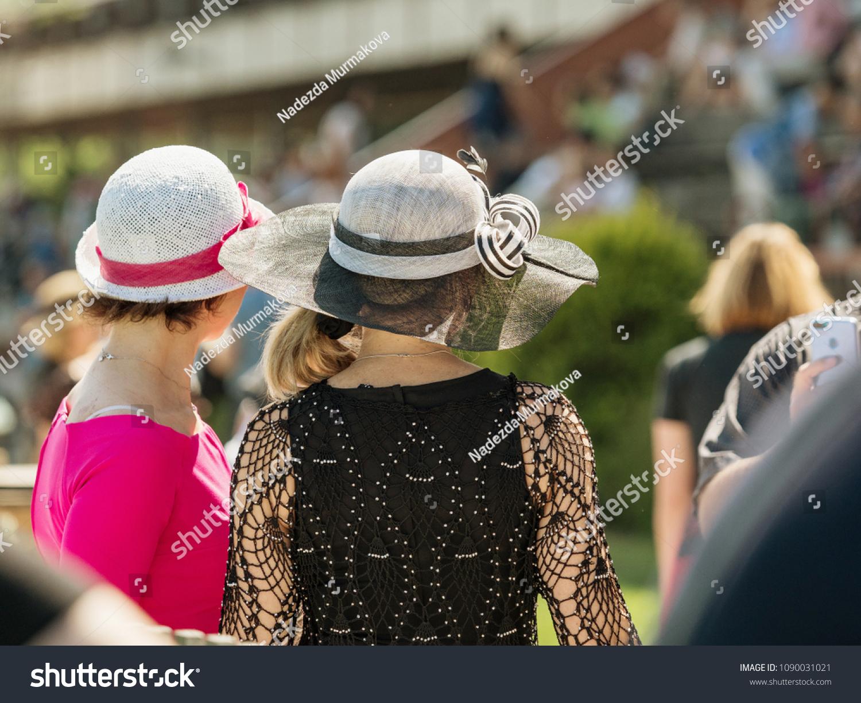 Ladies with hats on the race track. Romantic summer hats. Retro style  summer romance 4b567f9c591