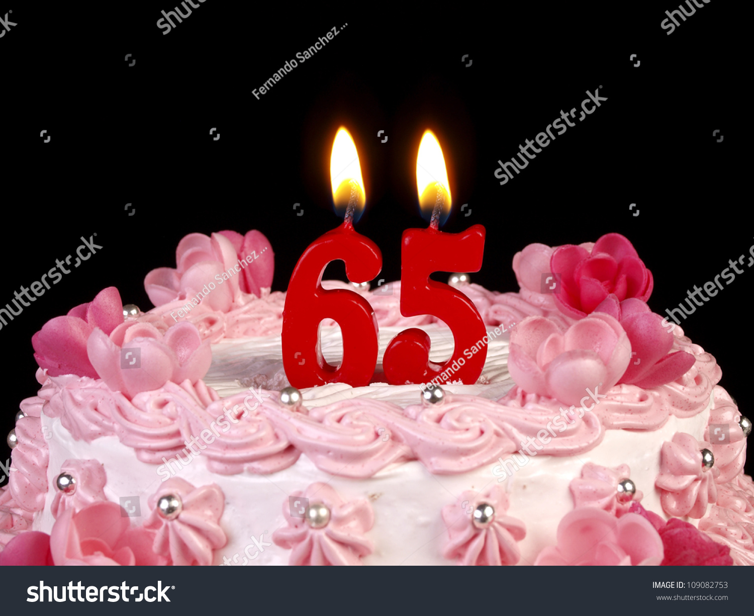 Birthday Cake With Red Candles Showing Nr 65 Stock Photo