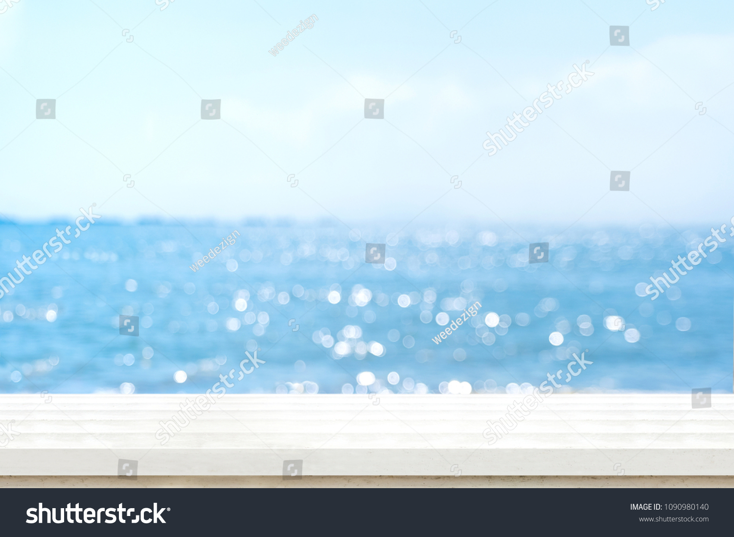Empty plank white wood table top with blur blue sky and sea boekh background,summer holiday backdrop.Mock up template for display or montage of product or content use as panoramic banner in ads.