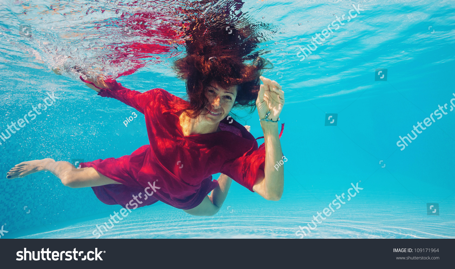 Underwater Woman With Red Dress In Swimming Pool Stock