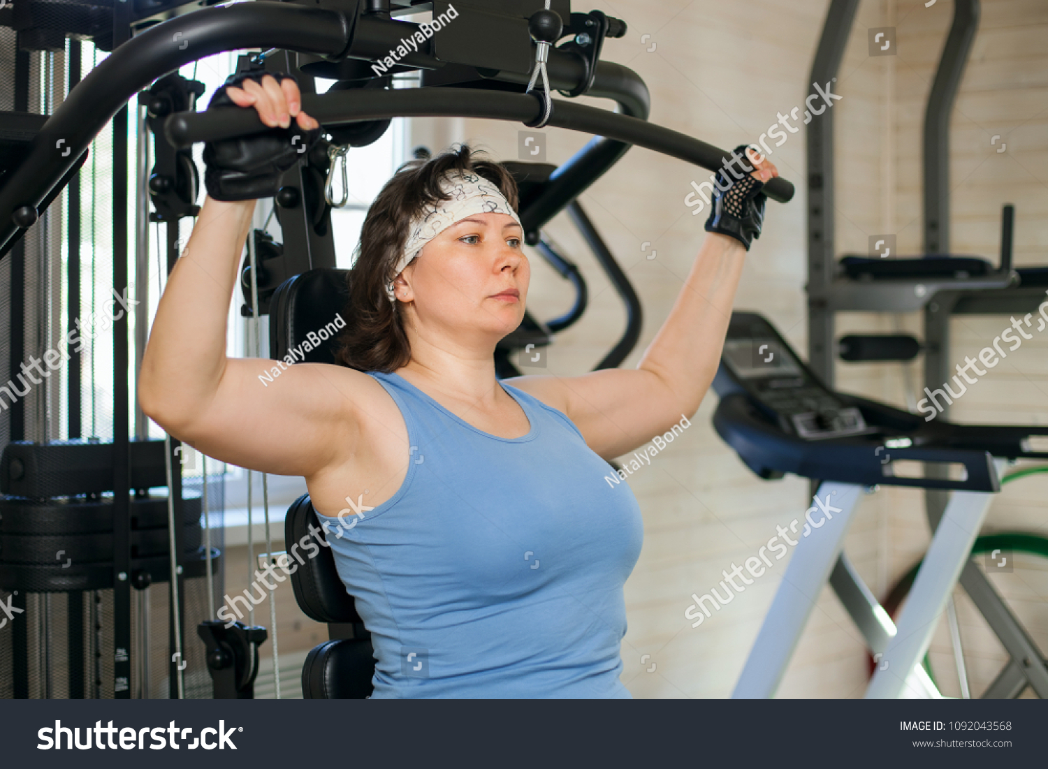 Overweight woman working out on training stock photo edit now