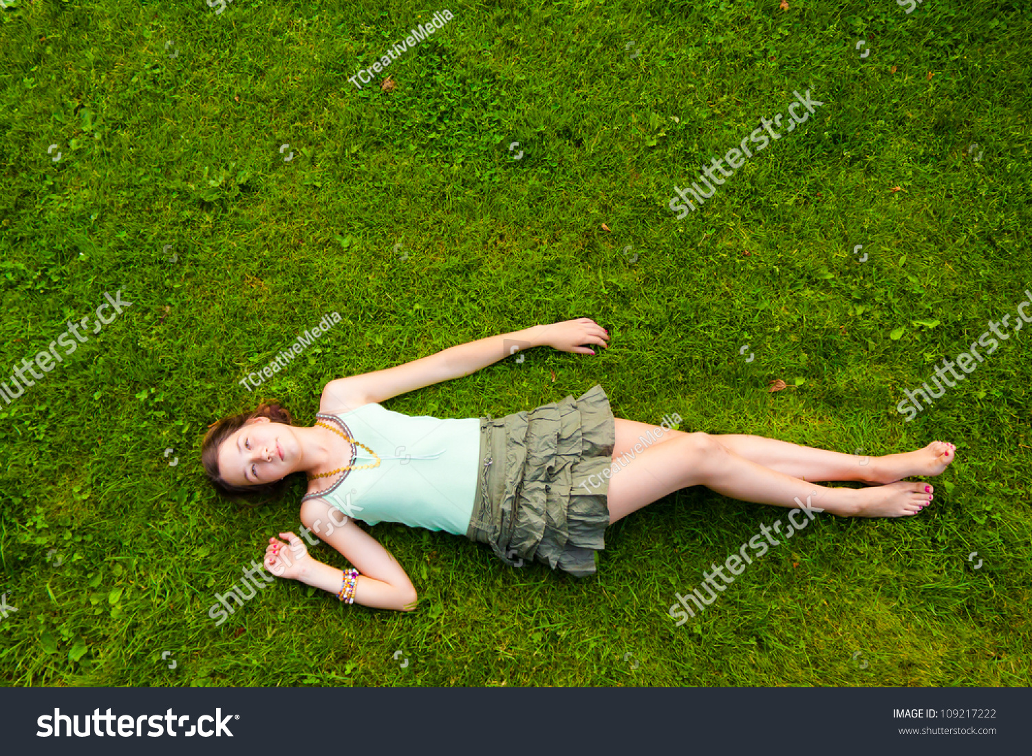 Pretty Young Girl Lying Down On Stock Photo 109217222