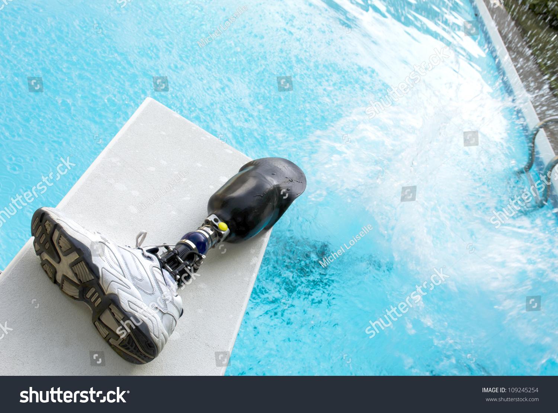 Pool Splash Cannonball cannonball splash pool prosthetic leg left stock photo 109245254