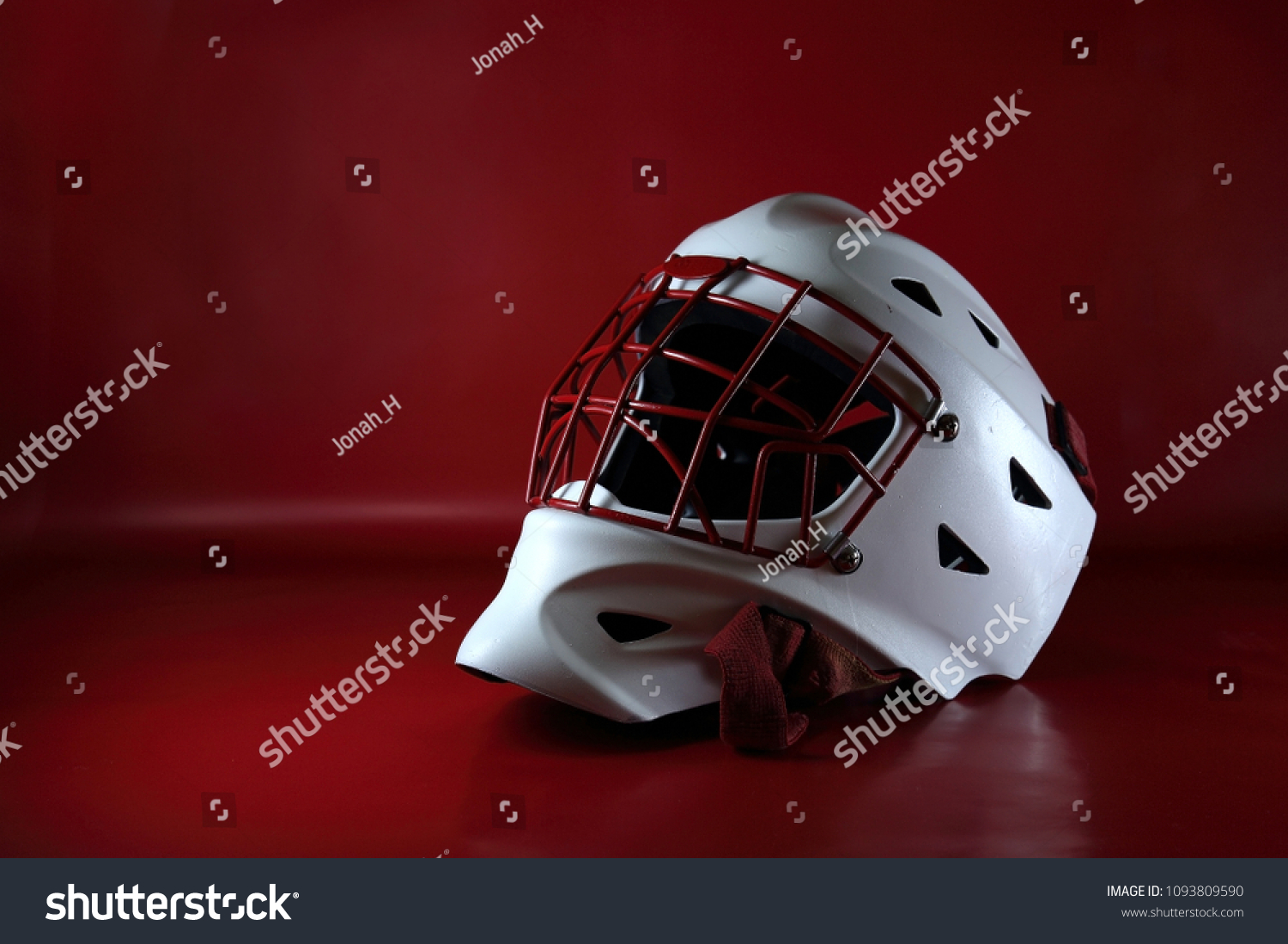 Hockey Goalie Mask Contrasted Against Deep Stock Photo Edit Now