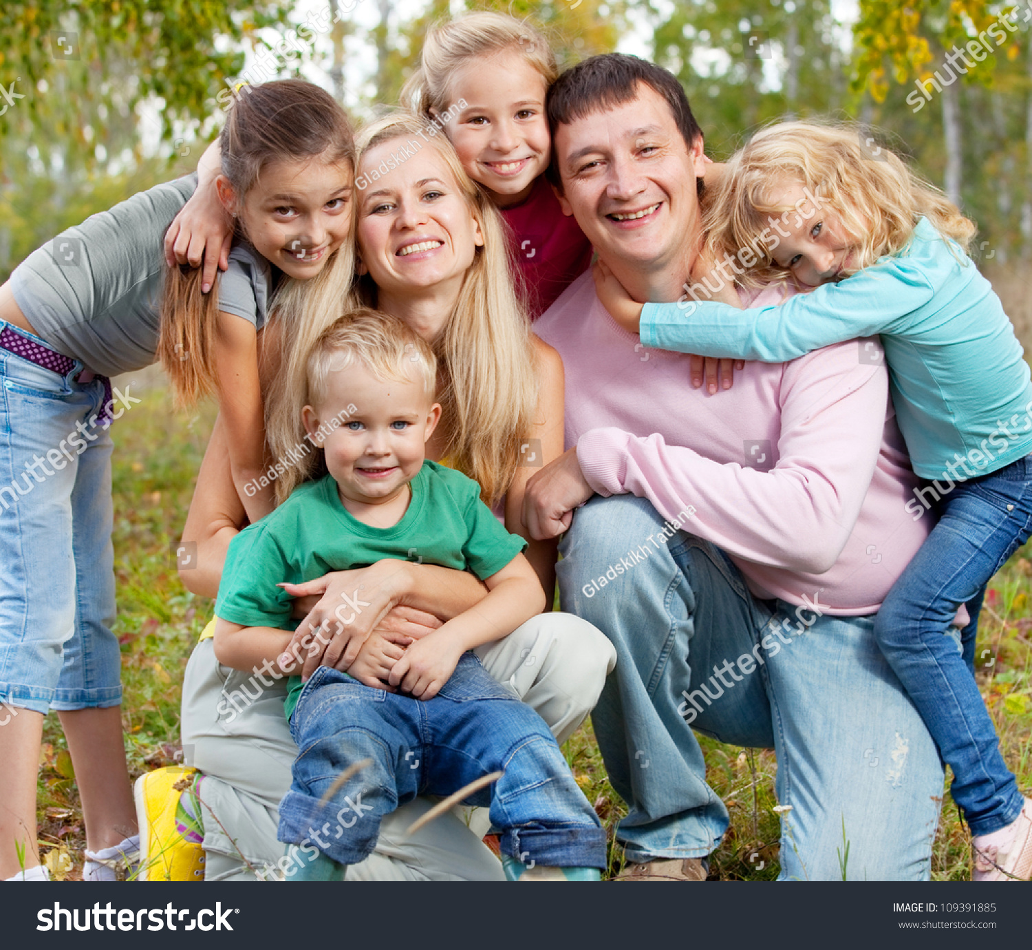 Kids Stock A Wide Selection Of Luxury Premium Cotton: Happy Large Family Children Autumn Park Stock Photo