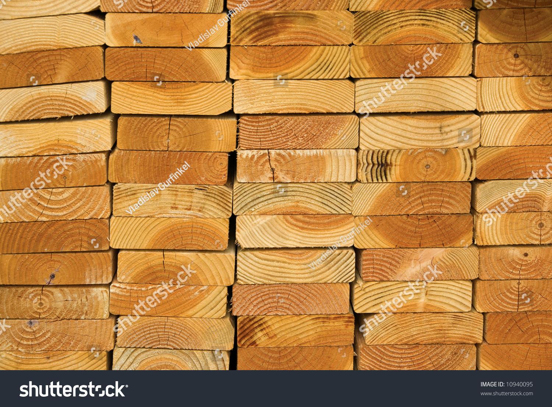Stack of wood planks on lumber yard stock photo