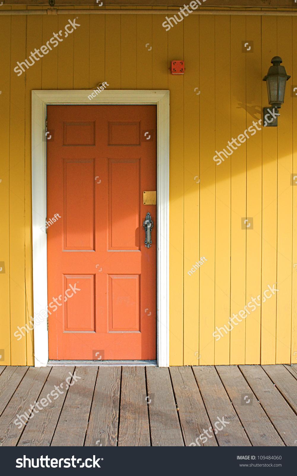 yellow house red door stock photo 109484060 - shutterstock