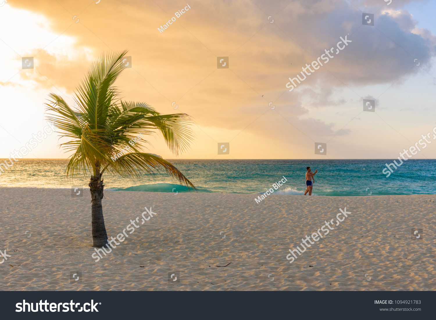 Oranjestad, Aruba - January 9, 2018: A gay couple stroll romantically on the