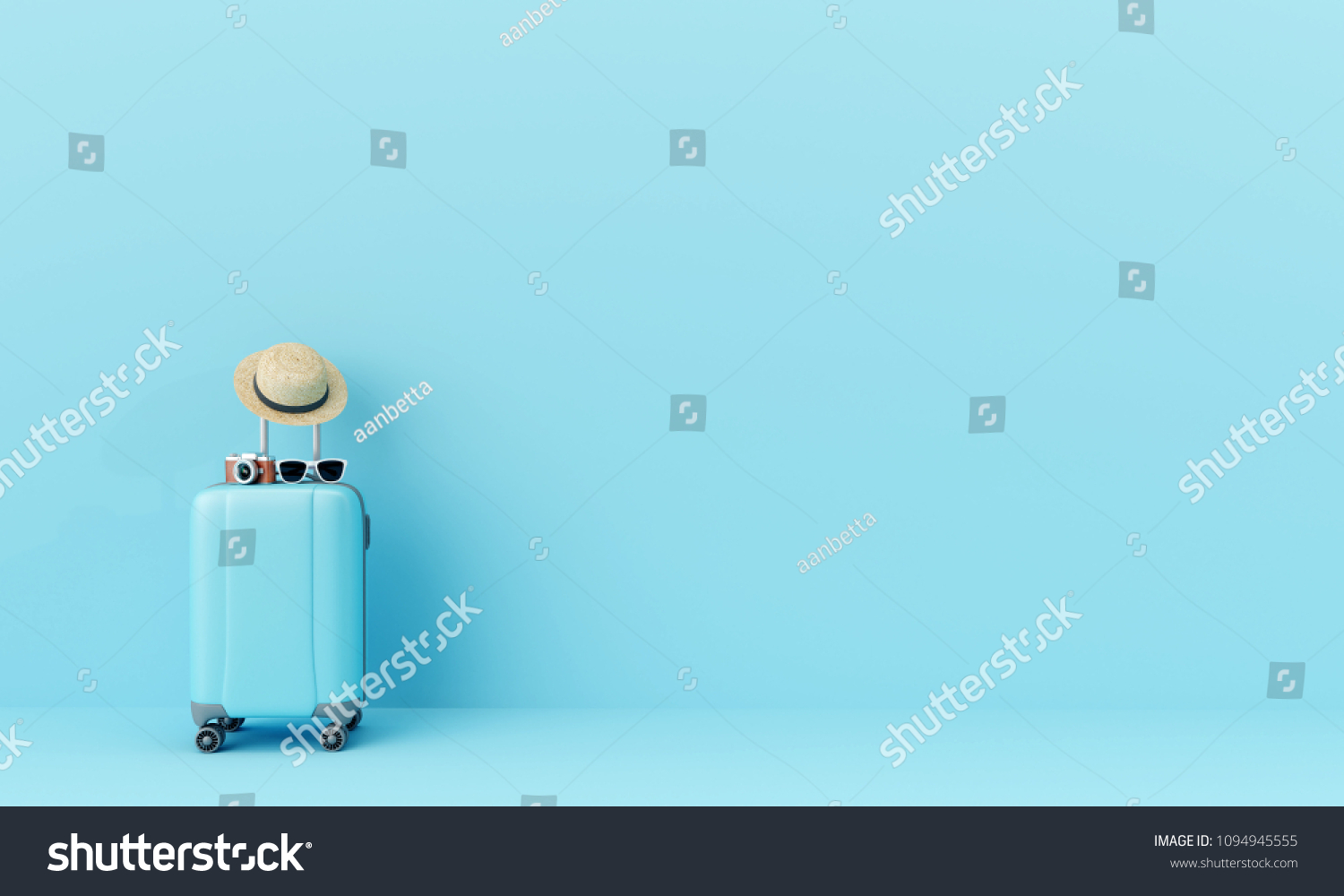 Blue suitcase with sun glasses, hat and camera on pastel blue background. travel concept. minimal style