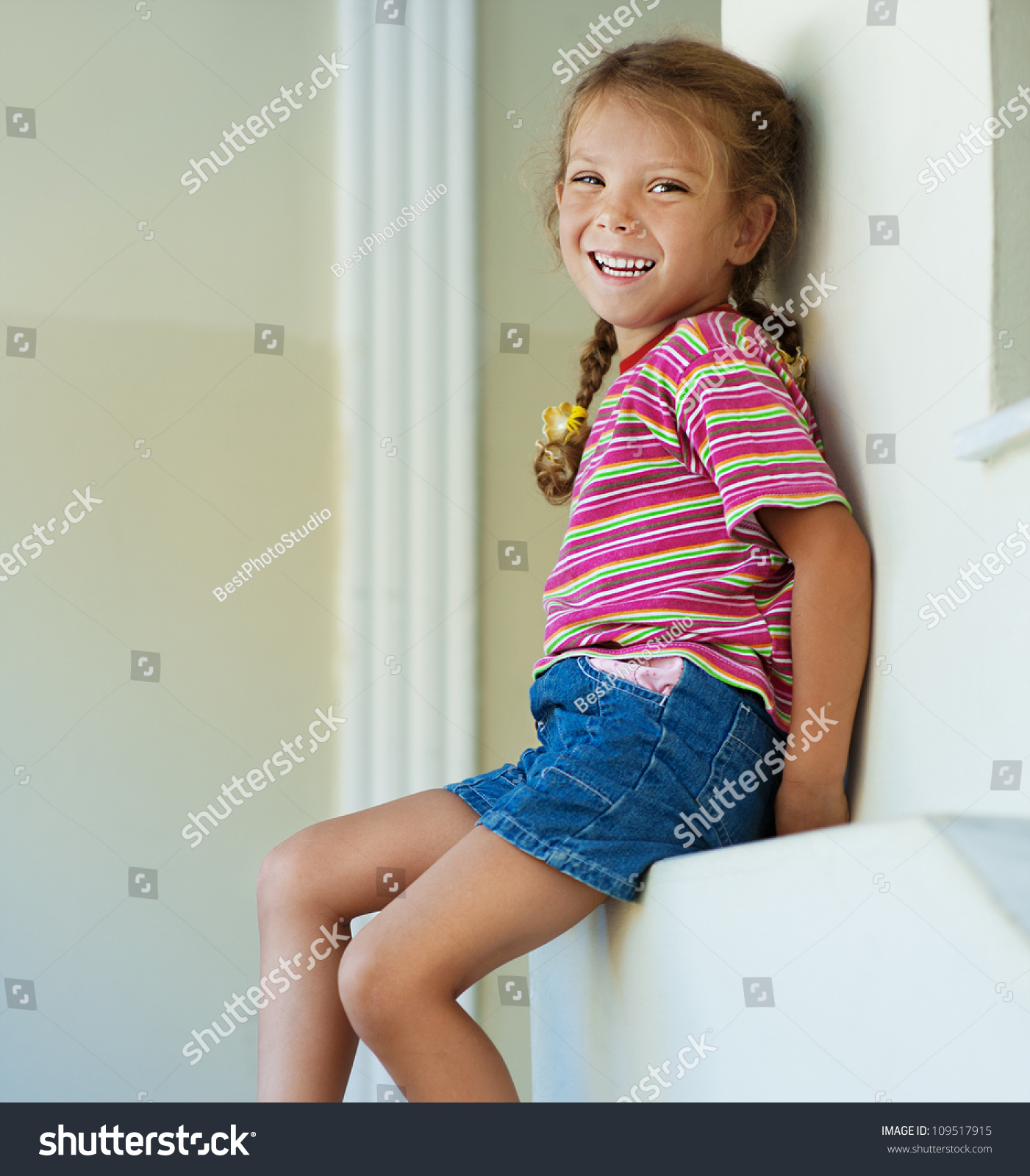 Beautiful Little Girl Bedrooms: Beautiful Little Girl In Shorts Sitting On Stone Ledge