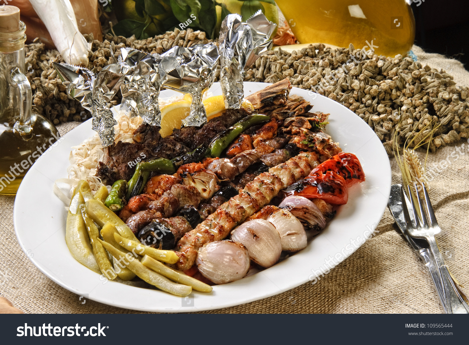 Plate of arabic oriental barbeque made of different kinds for Arabic cuisine names