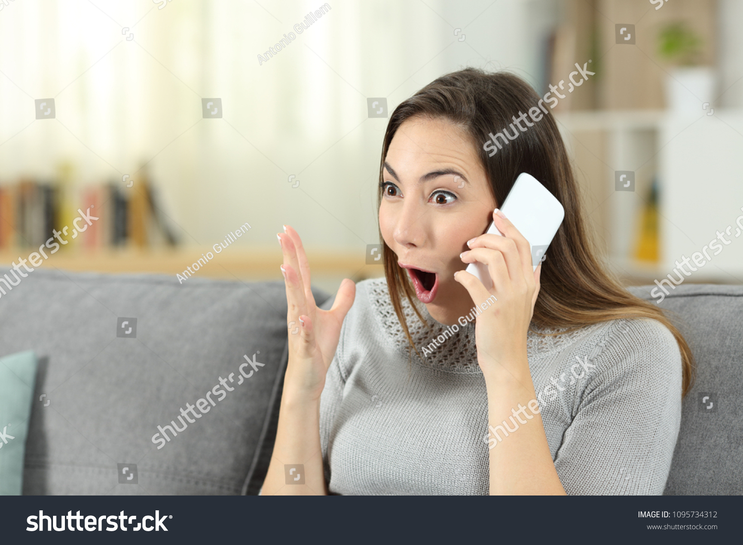 stock-photo-amazed-woman-calling-on-phon