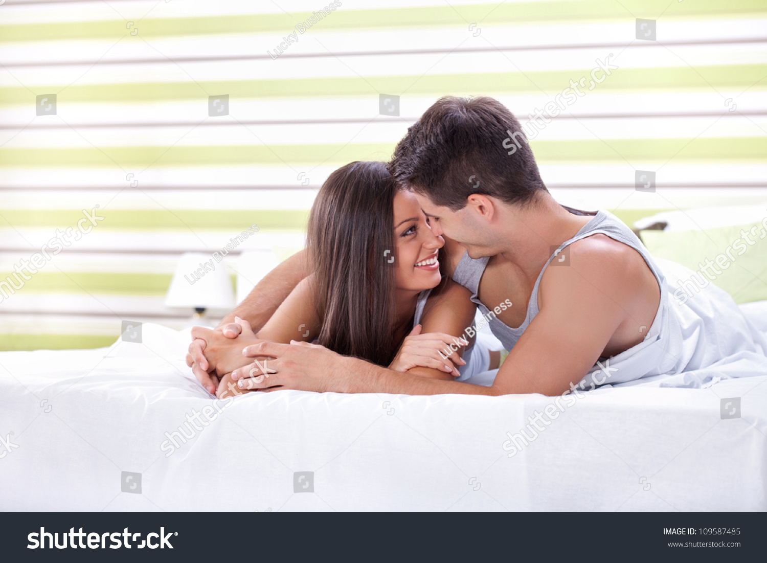 Young love couple in bed  romantic scene in bedroom. Young Love Couple Bed Romantic Scene Stock Photo 109587485