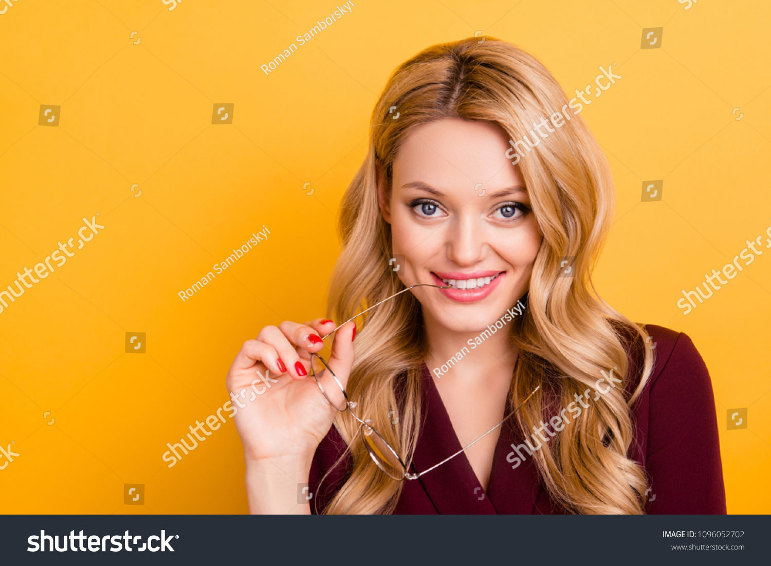 5b6495f69473 Portrait of pretty lovely lady in formalwear biting eyelet of glasses  looking at camera with flirting