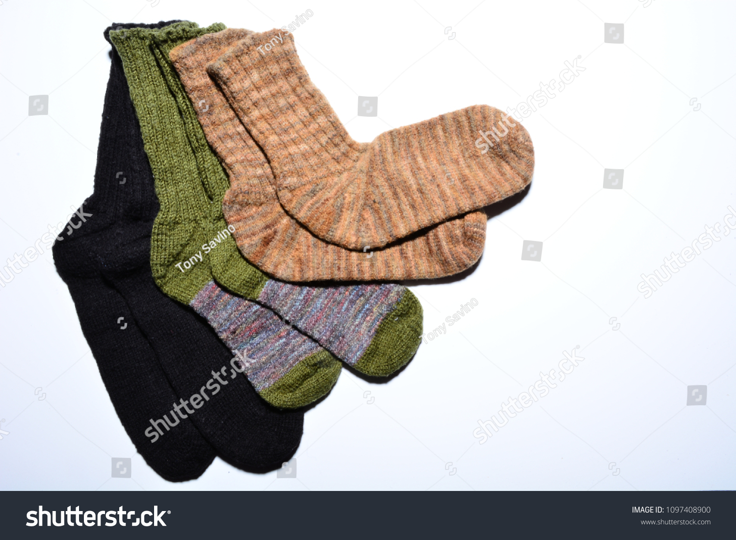 stock-photo-three-pairs-of-hand-knit-sox-beige-black-plus-green-and-variegated-violet-1097408900.jpg