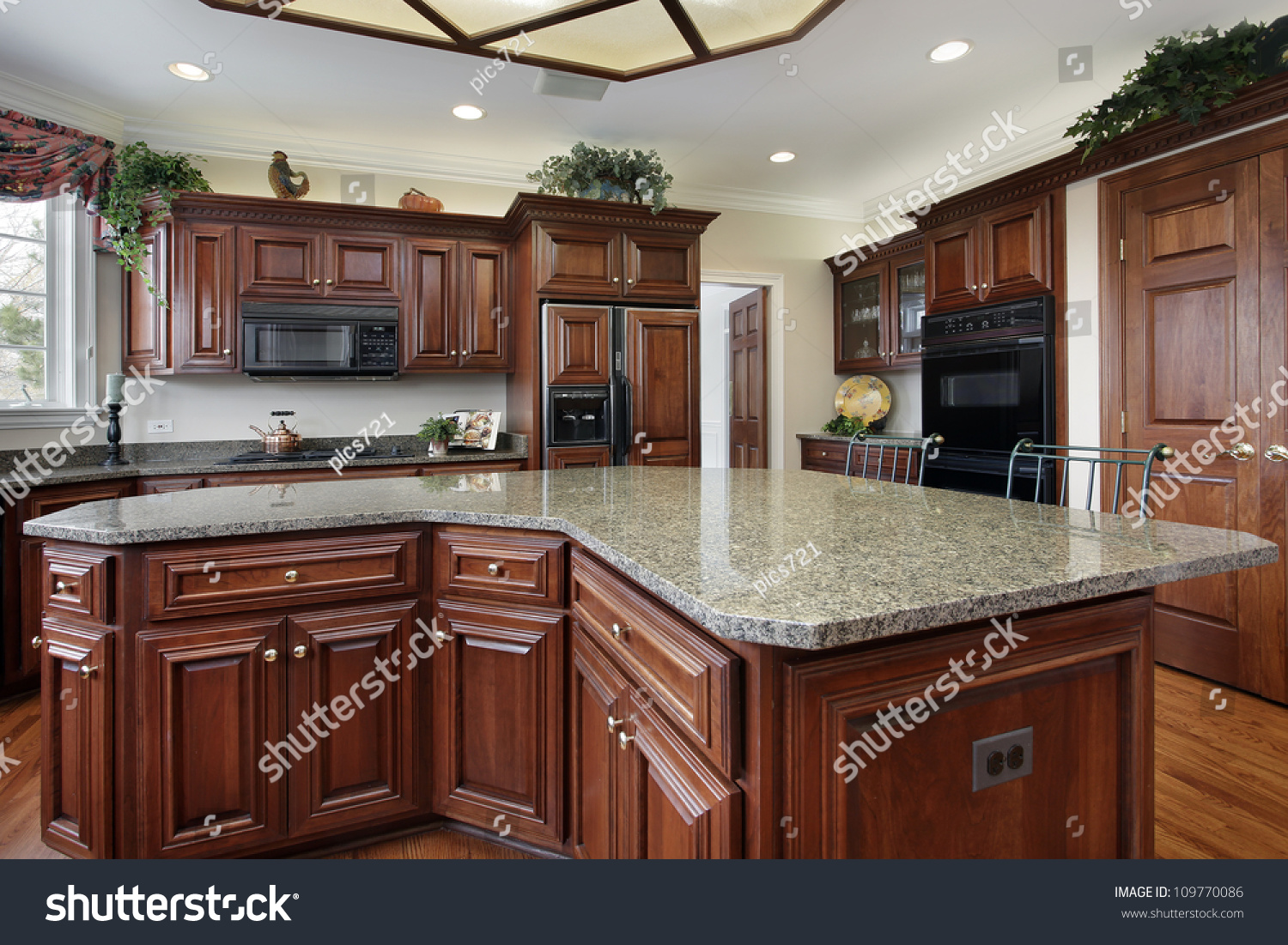 Kitchen Center Island Kitchen In Luxury Home With Large Center Island Stock Photo