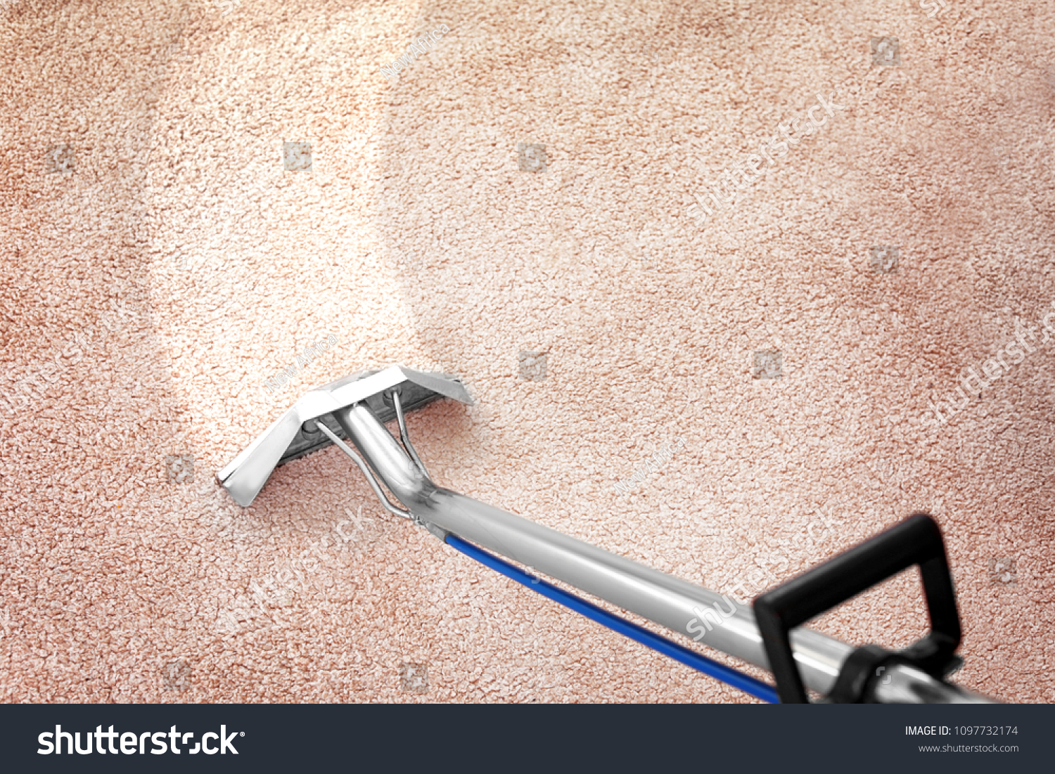 Removing dirt from carpet with professional vacuum cleaner indoors #1097732174