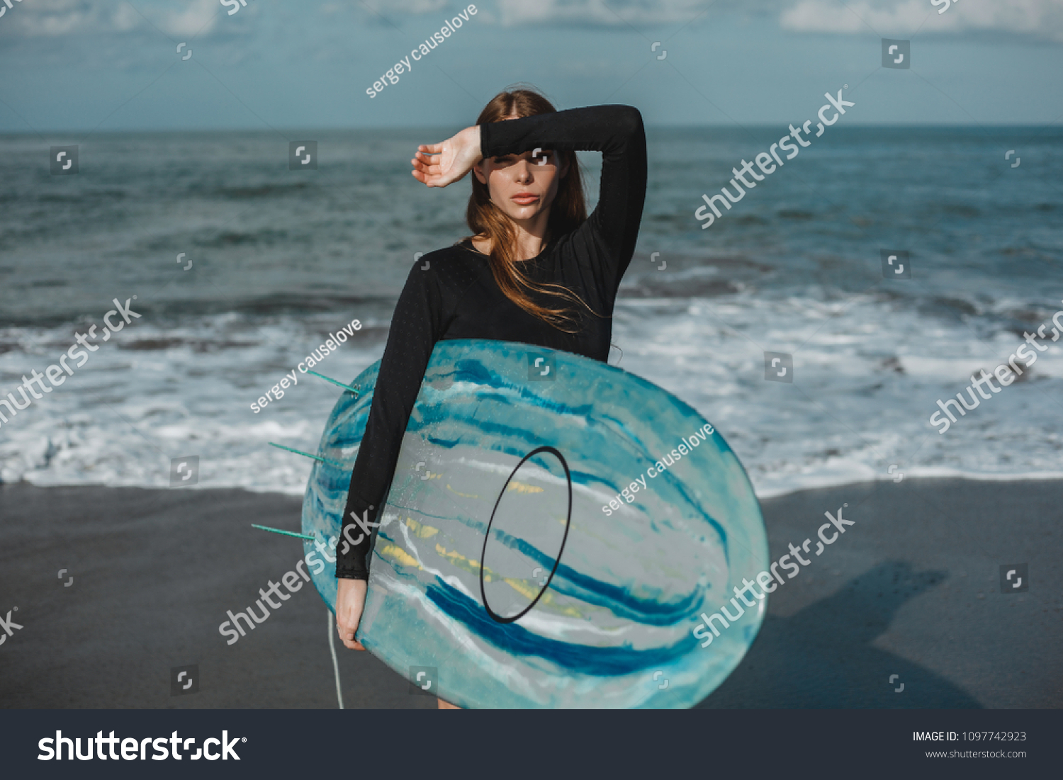 21bc5d2df17 Surf girl with long hair go to surfing. Young surfer woman holding blank  white short