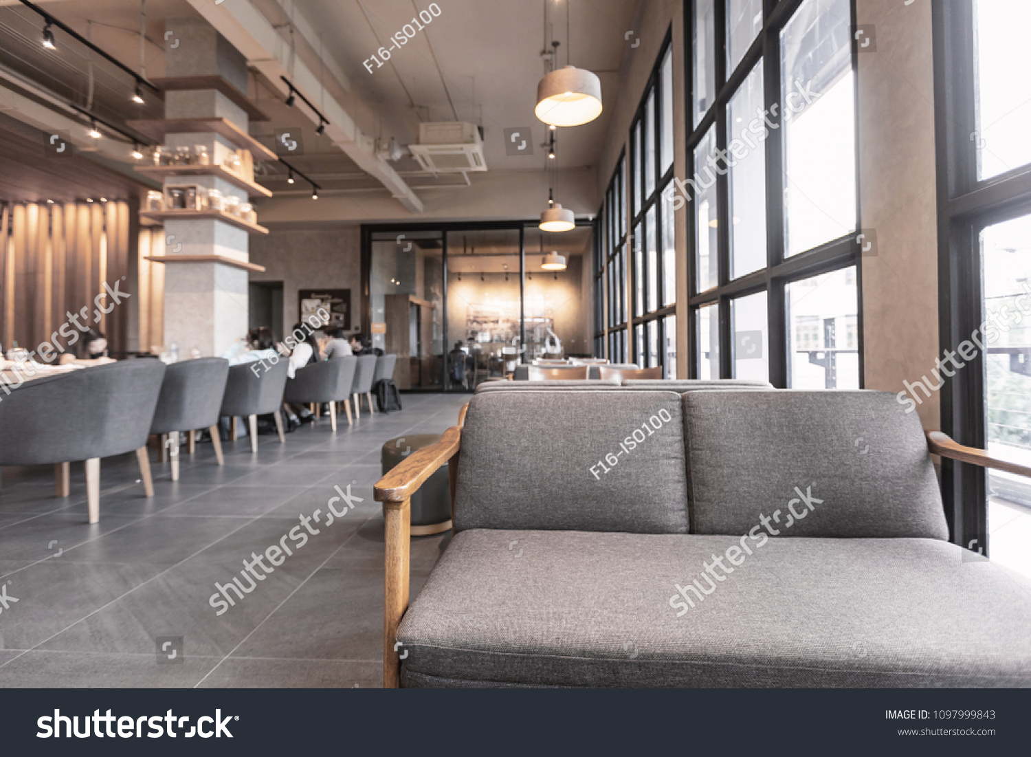 Modern interior of coffee shop decorate with wooden furniture in warm lighting tone for relaxing time