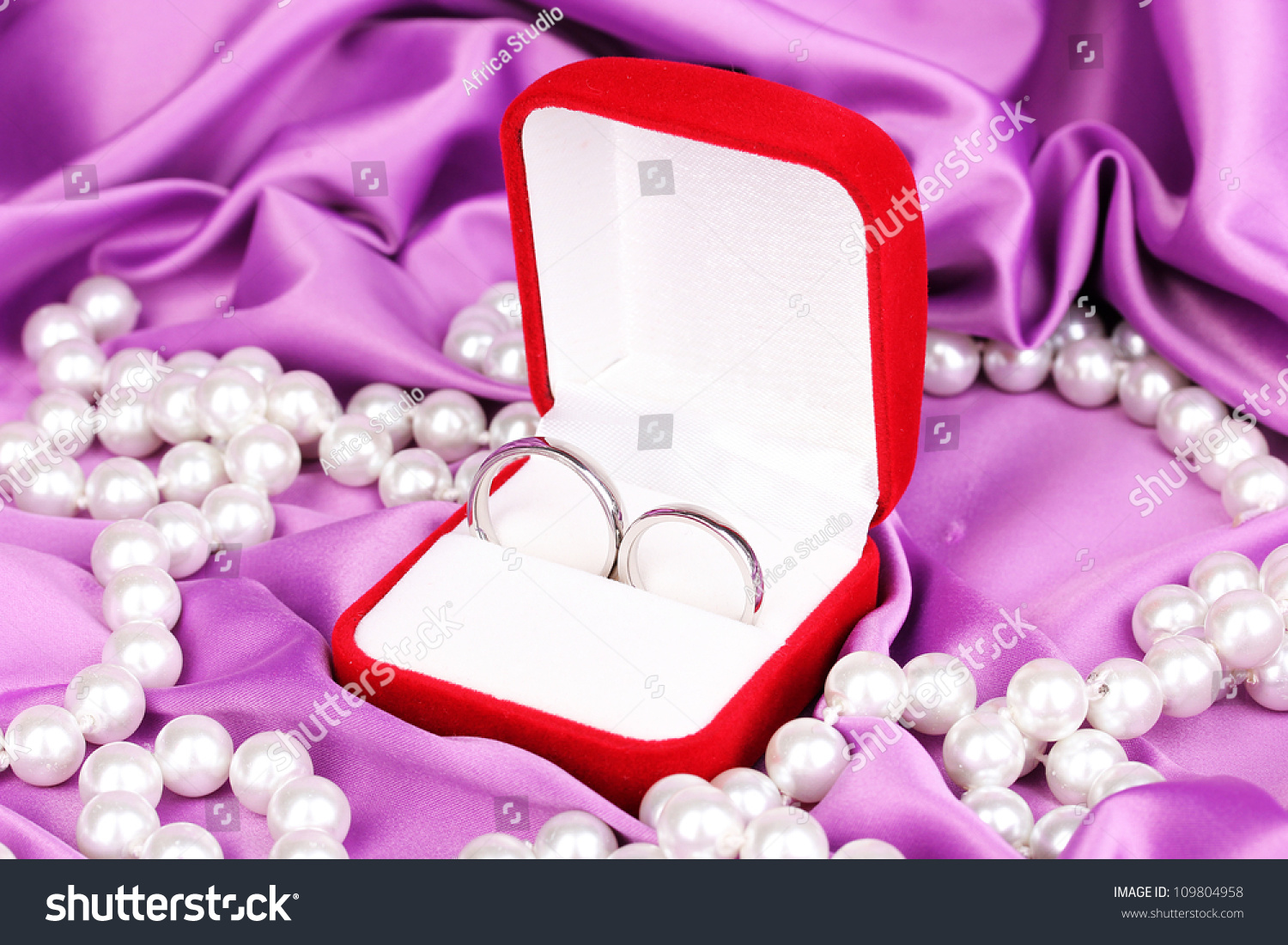 wedding rings red box on purple stock photo 109804958