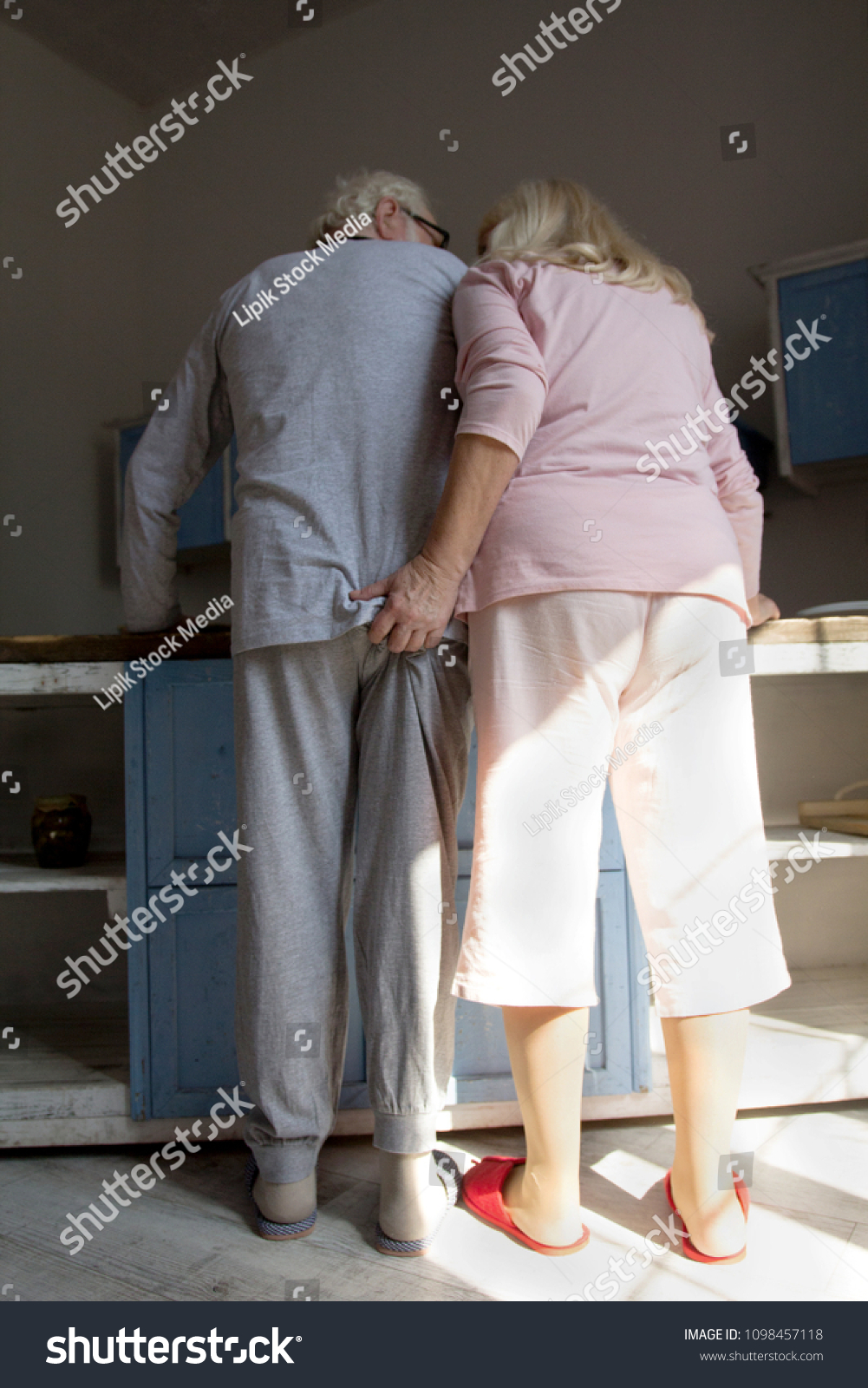 Old Mature Ass old lady grabbing her husbands butt stock photo (edit now