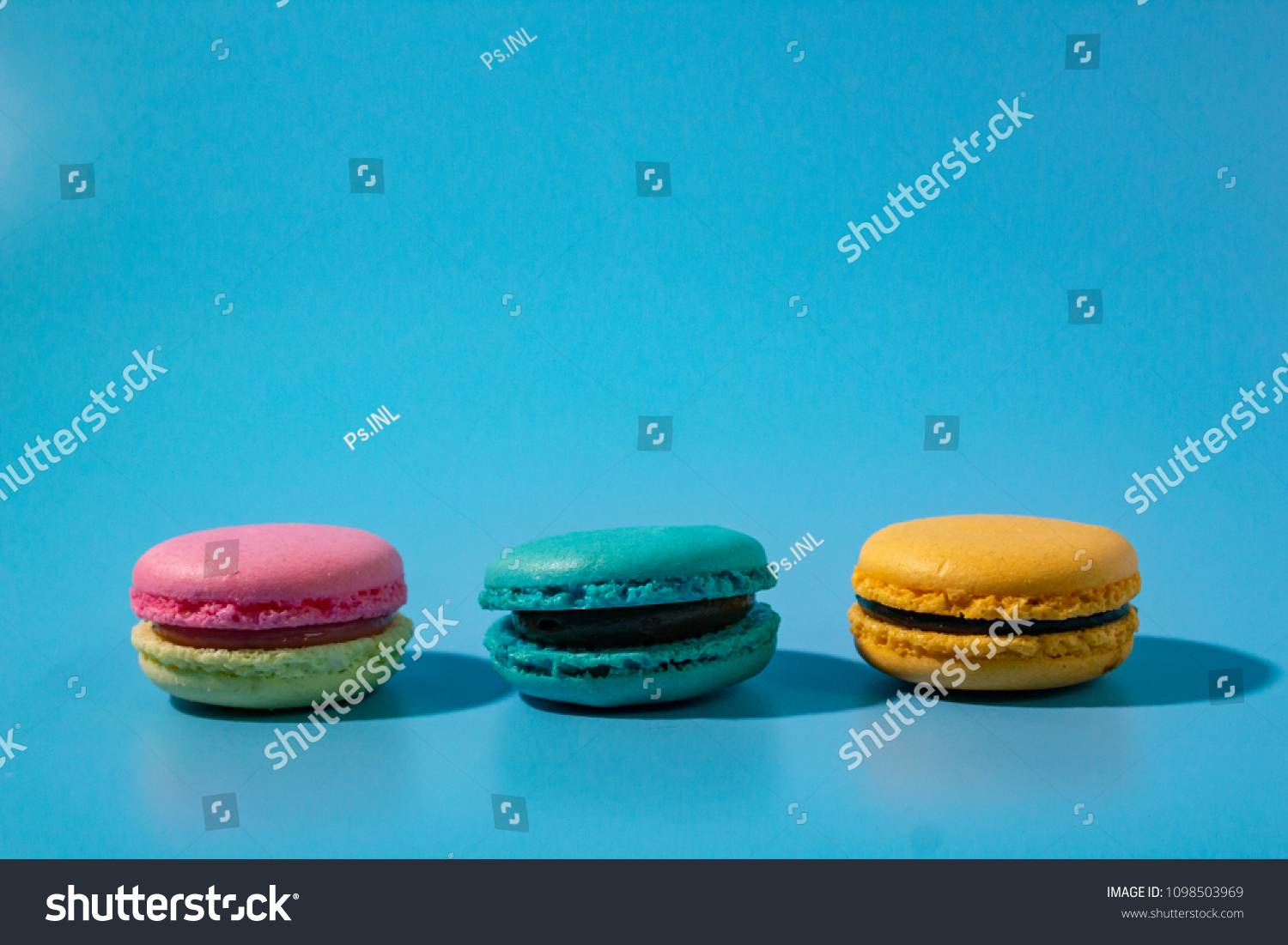 Macarons On Cyan Background Stock Photo Edit Now 1098503969