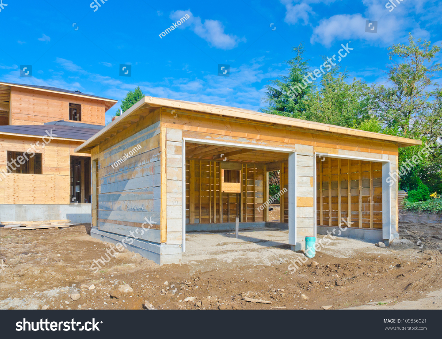 Double doors garage house home under stock photo 109856021 for Construction garage double
