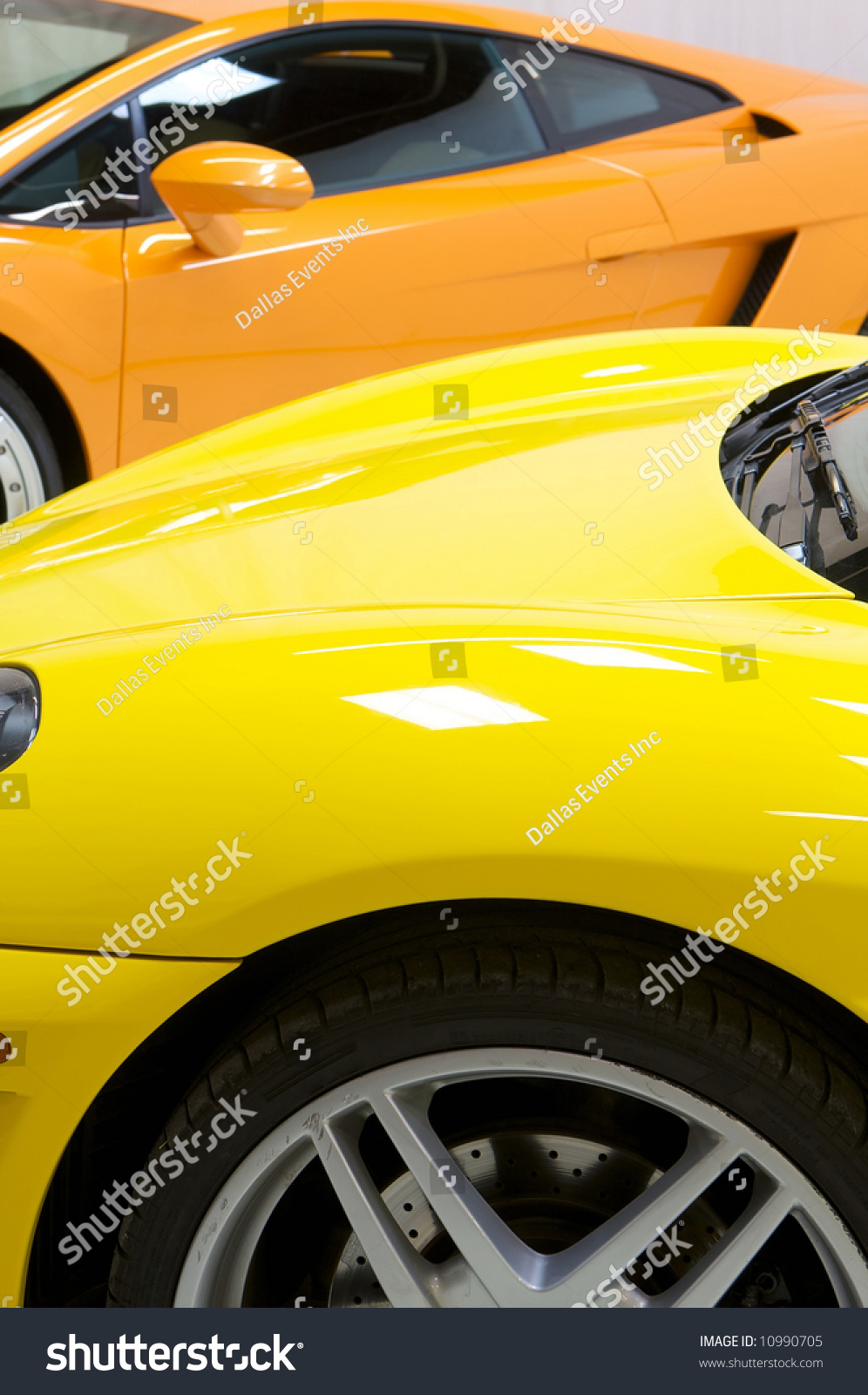 An Image Of A Italian Sports Cars In Yellow And Orange