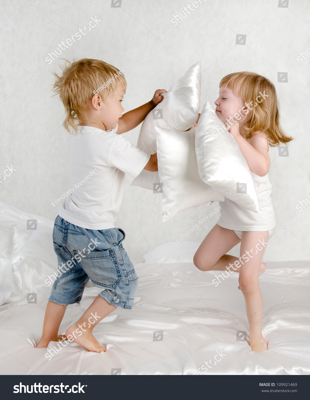 Happy Laughing Brother And Sister Having A Pillow Fight In ...
