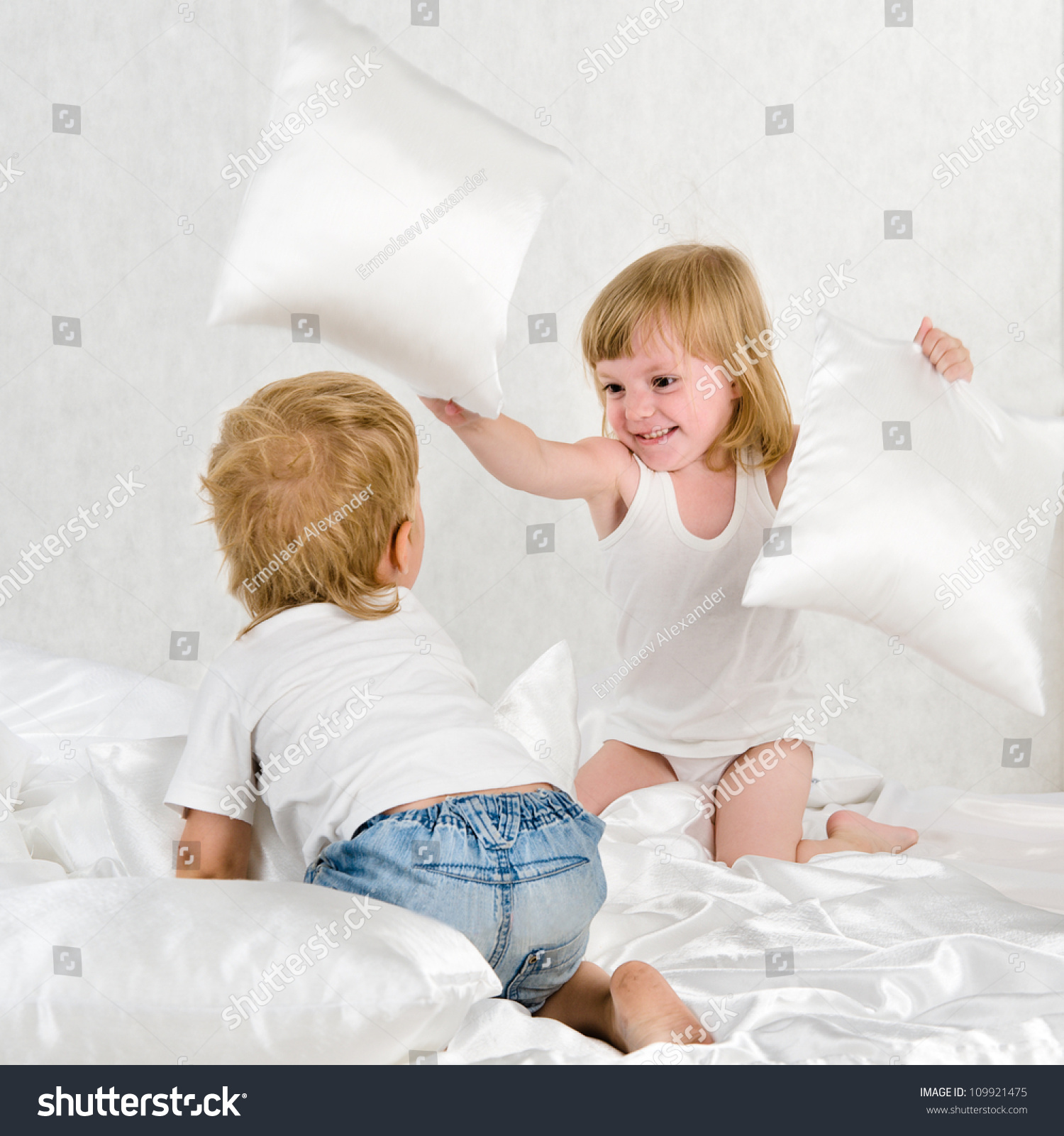 Portrait Kids Fighting With Pillows In Bed - Indoor Stock ...