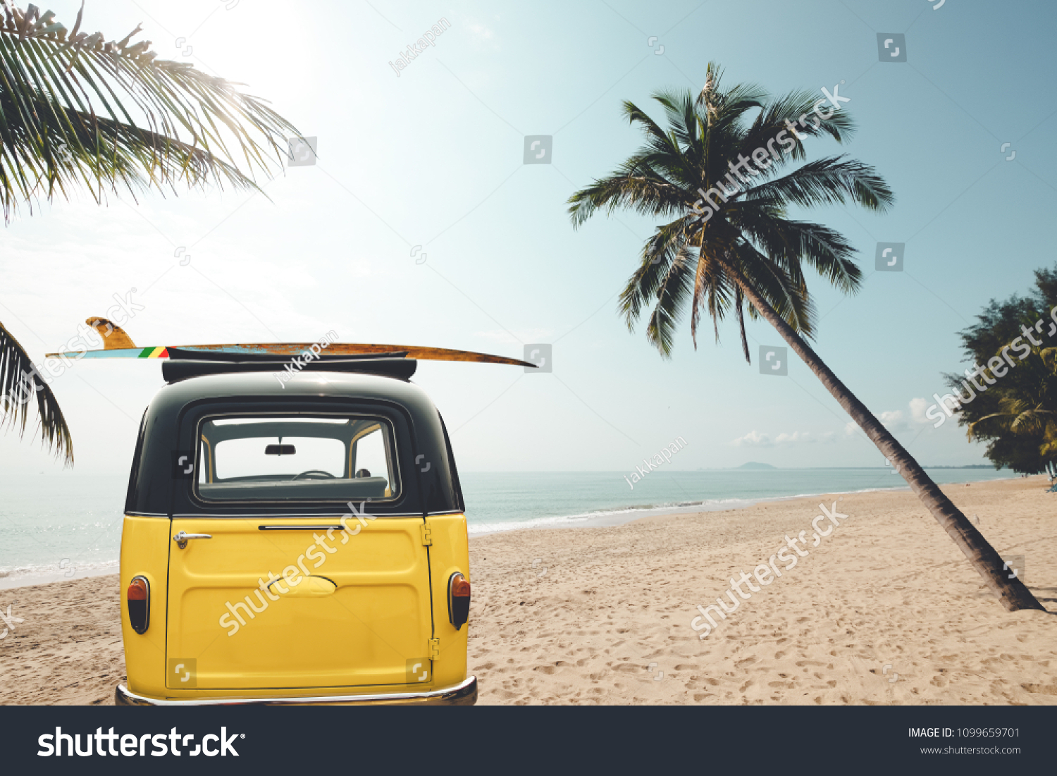 Rear of vintage car parked on the tropical beach (seaside) with a surfboard on the roof - Leisure trip in the summer. retro color effect #1099659701