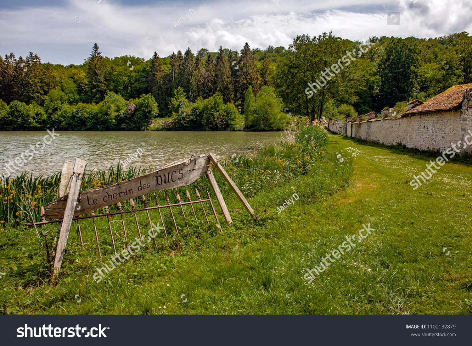 MORTEMER, FRANCE - MAY 26TH, 2018. Park of the Abbey of Mortemer in the Department of the Eure. Panel out of wooden, shows the way of the dukes.
