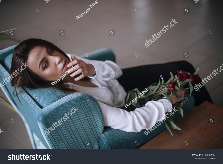Beautiful Girl Sitting On Blue Velvet Stock Photo Edit Now