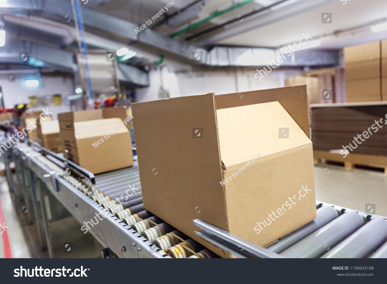 Cardboard boxes on conveyor belt. Board, package. #1100643188