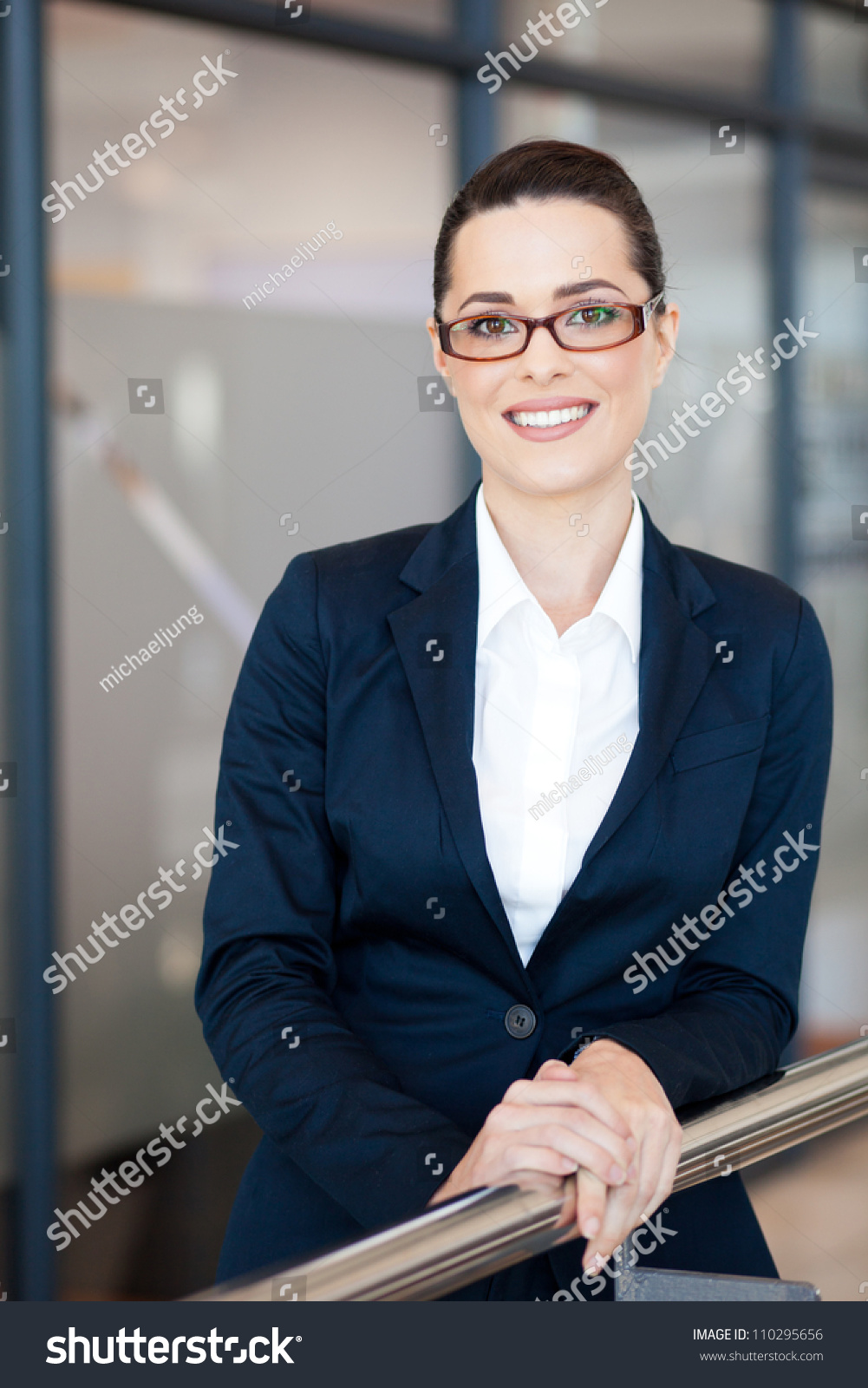 Beautiful young businesswoman portrait office stock photo 110295656 shutterstock - Office portrait photography ...