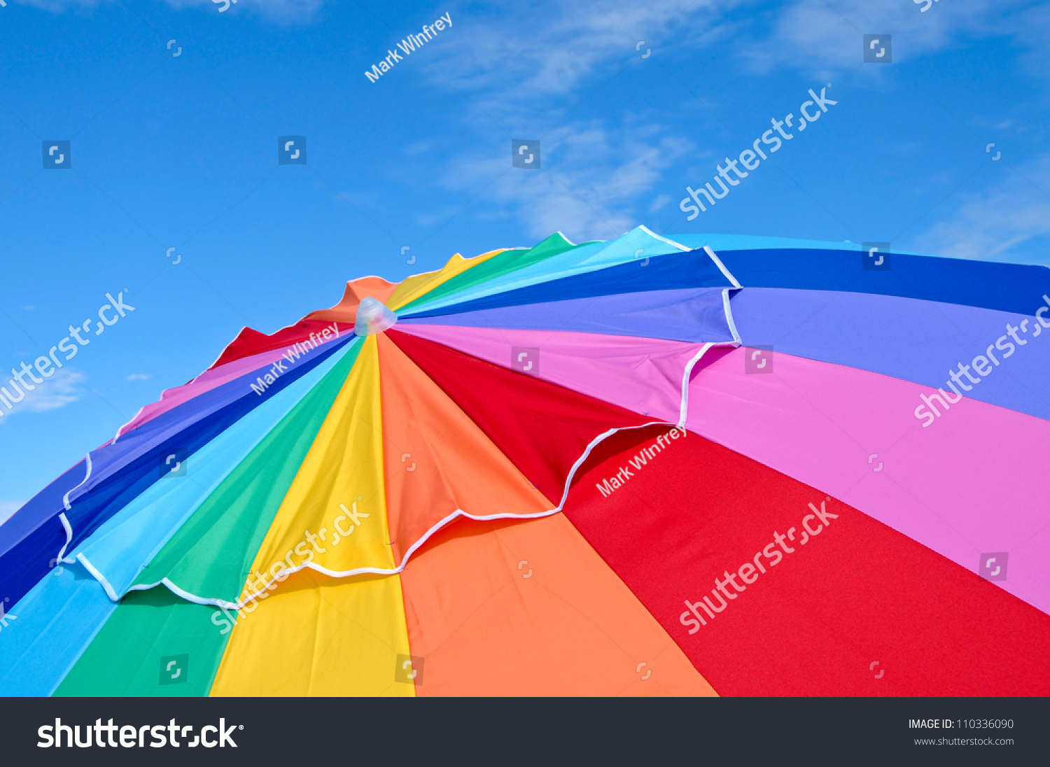 Top of a Colorful Beach Umbrella against the Sky