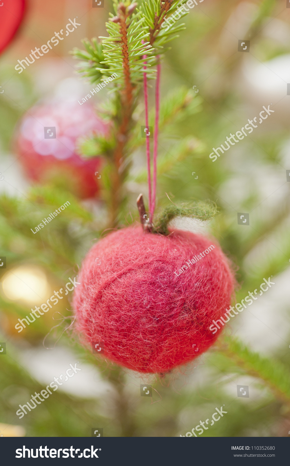 Decoration in shape of an apple hanging in a christmas for Apple tree decoration