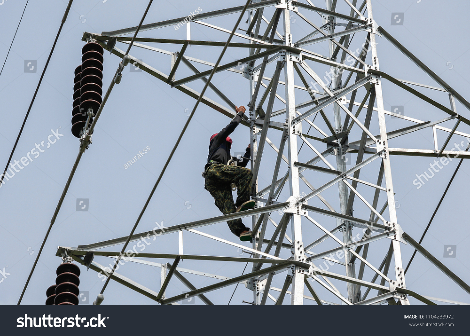 Lineman Climbing On Transmission Line Tower Stock Photo Edit Now 1104233972