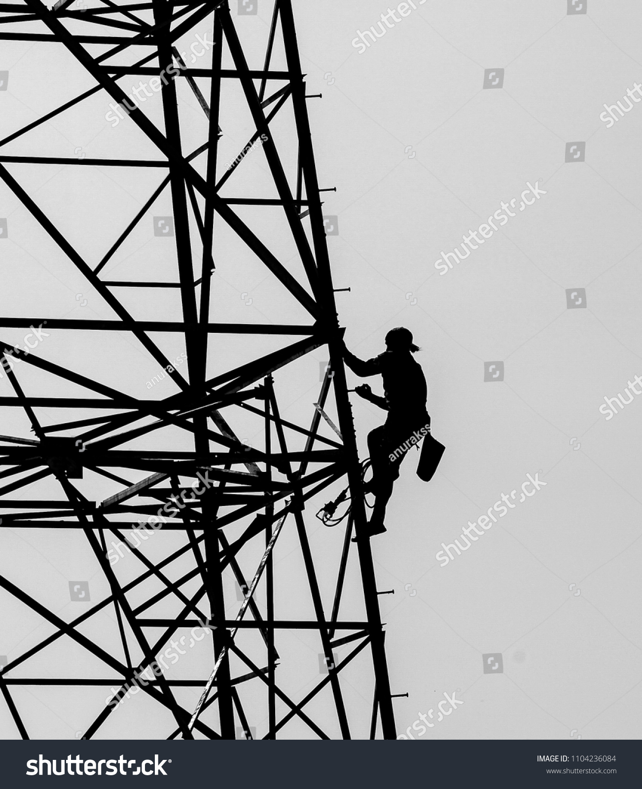 Silhouette Lineman Climbing On Transmission Line Stock Photo Edit Now 1104236084