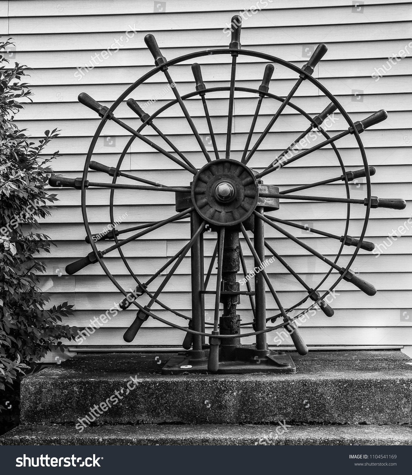 Circles in circles and lines a black and white artsy view of a ships wheel