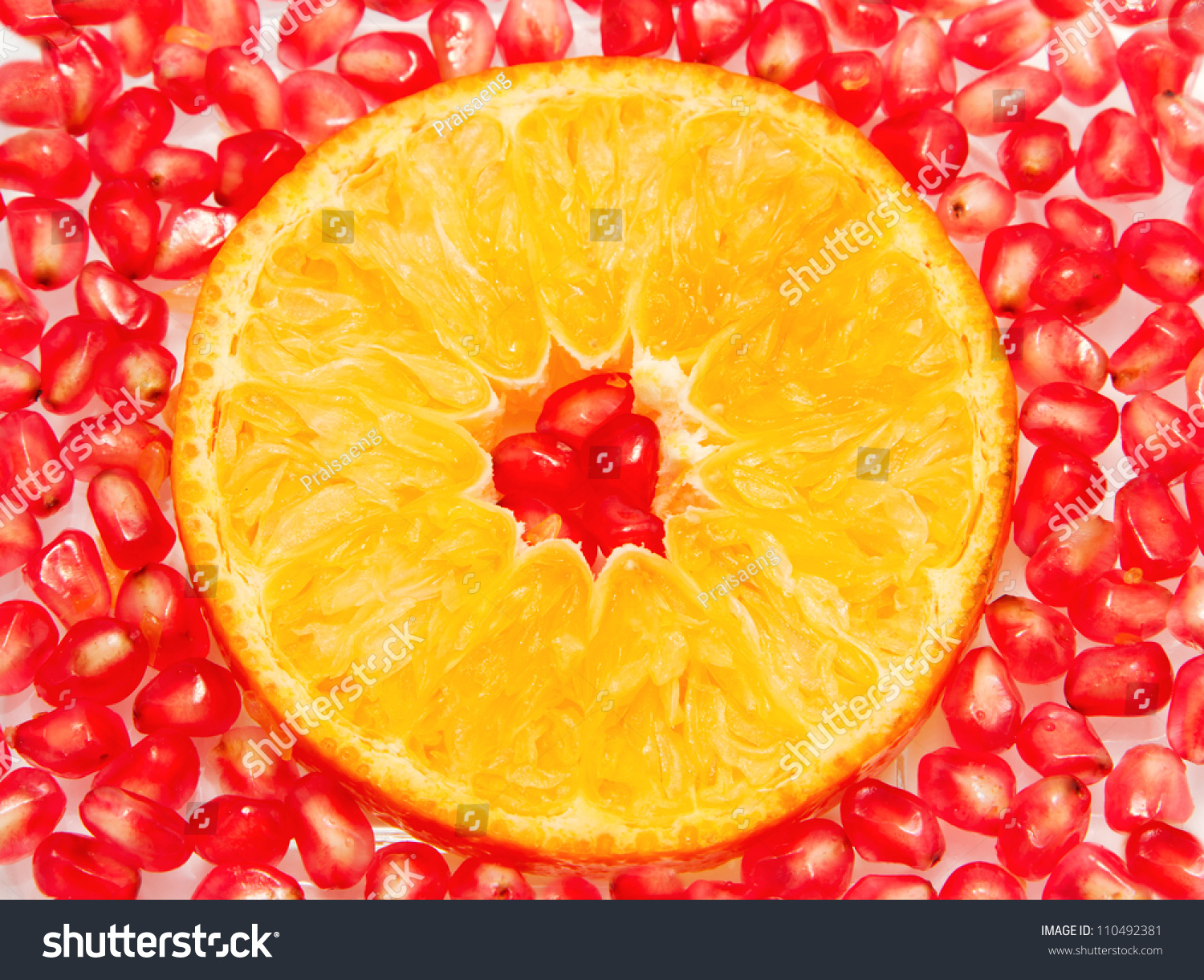 Orange Slices And Pomegranate Seed Isolated On White Background Stock ...