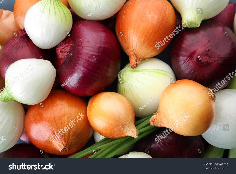 Fresh onions as background. Organic food #1105628000