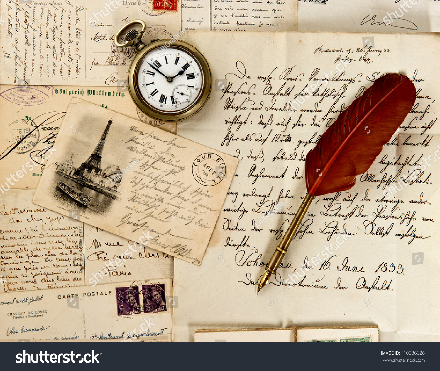 Old letter paper with feather