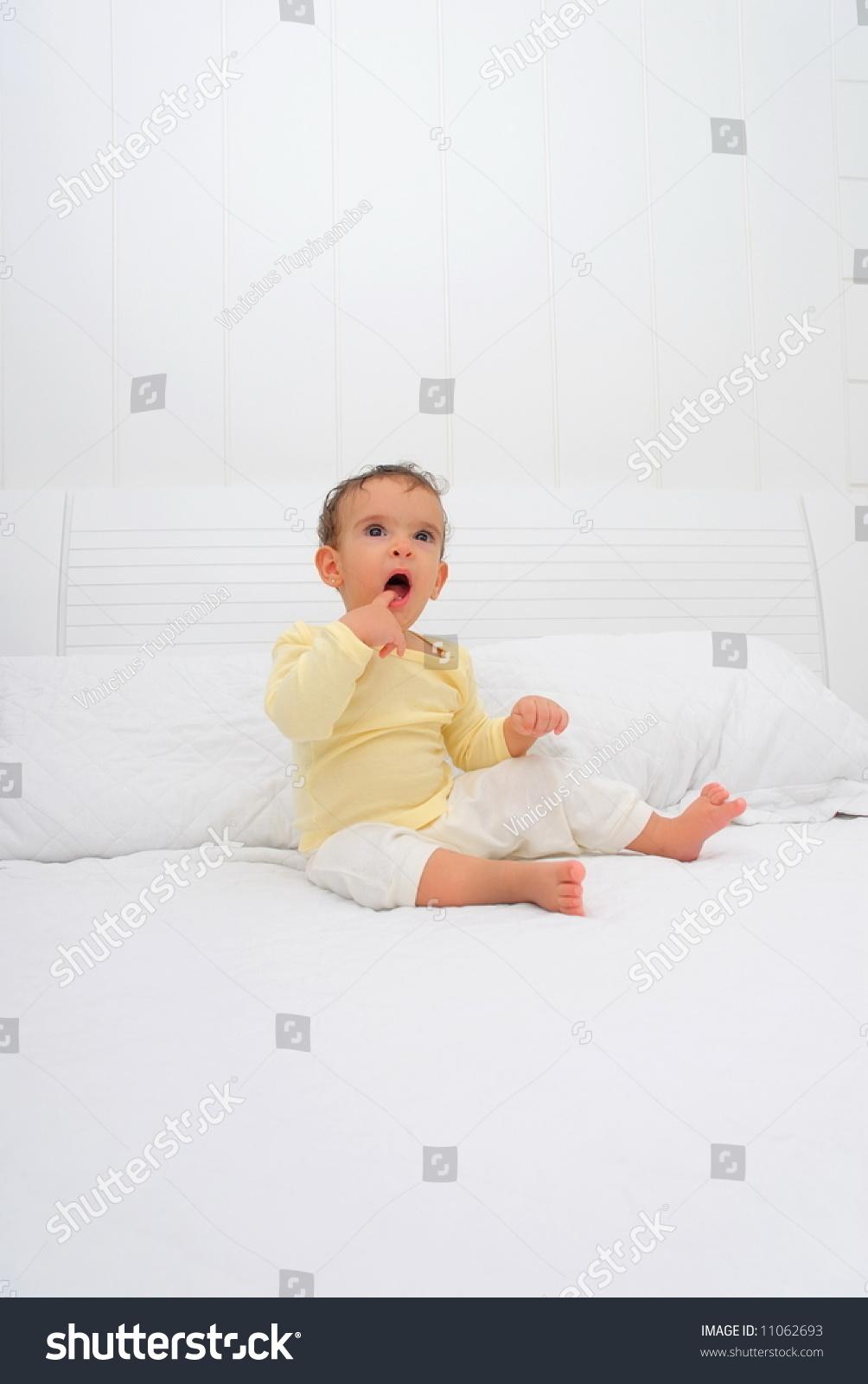 Sleepy Baby Seating On Bed Stock Photo 11062693 - Shutterstock